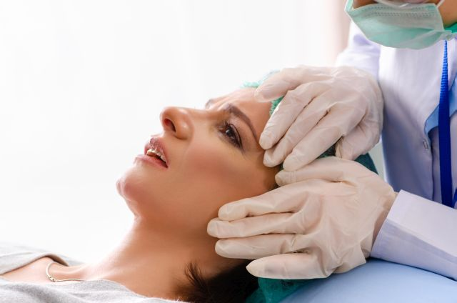 Woman preparing for cosmetic plastic surgery